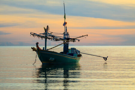 Fishing boats floating in the bay , Prachuap Khiri Khan, Thailand photo