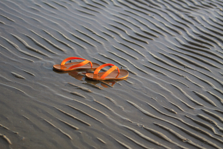 Shoes on the beach in the morning photo