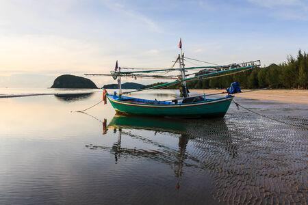 Fishing boats on the beach photo