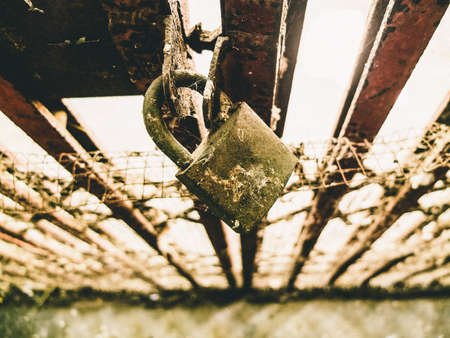 unbar: Old steel door is locked