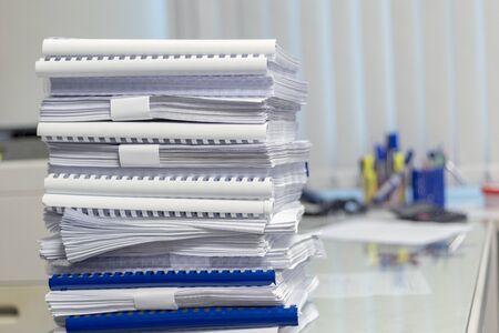 Business Concept, Pile of unfinished documents on office desk Banco de Imagens