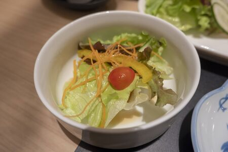 Vegetable salad in a white cup