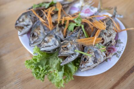 Fried mackerel placed in a plate on the table 版權商用圖片