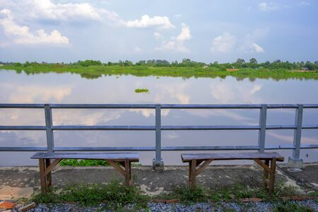 Wooden seat By the river 版權商用圖片