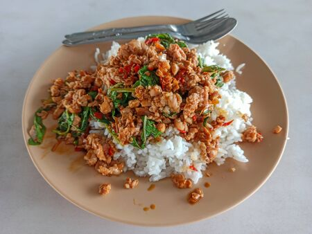 Thai Food Rice topped with stir-fried pork and basil