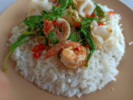 cooked rice with Stir fried shrimp basil