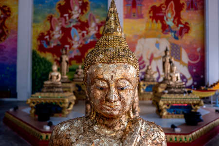 Golden Buddha statue in the temple , Thailand
