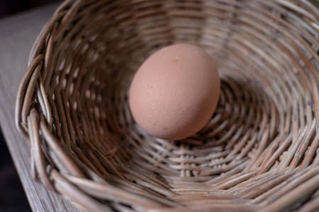 Boiled eggs in wooden basket