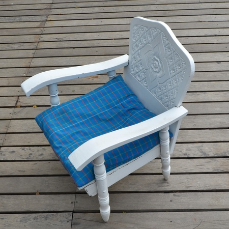 Classic blue chair on a wood background photo