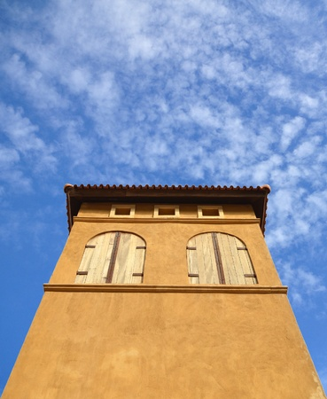 building in italian style and blue sky photo