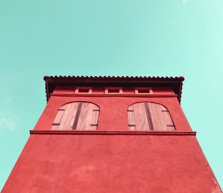 italian style building in red color photo