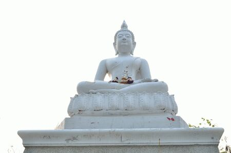 White Buddha statue and blue sky photo