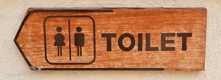 toilet plate sign on orange wall Stock Photo - 13505821