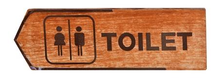 excrete: toilet plate sign on orange wall