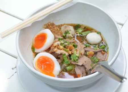 closeup Thai pork Noodles with Boiled egg