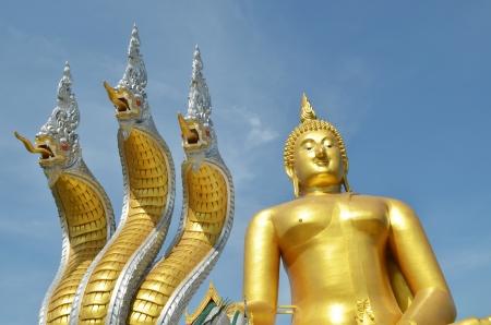 Thai dragon, King of Naga statue with three heads and Big buddha statue in Thailand photo
