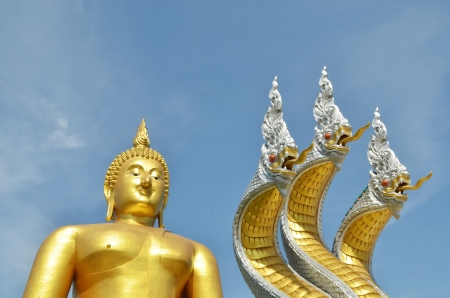 Thai dragon, King of Naga statue with three heads and Big buddha statue in Thailand photo