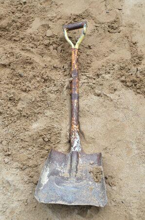 Soil with shovel. Close-up photo