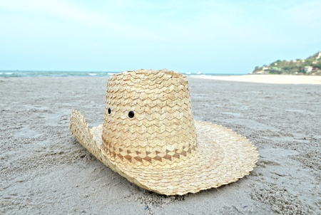 Hat on tropical island beach photo