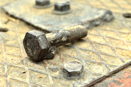 The rusted old iron nut which cant be turned off photo