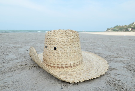 Hat on tropical island beach photo