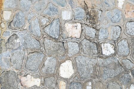 Weathered antique old cracked stone blocks wall retro background photo