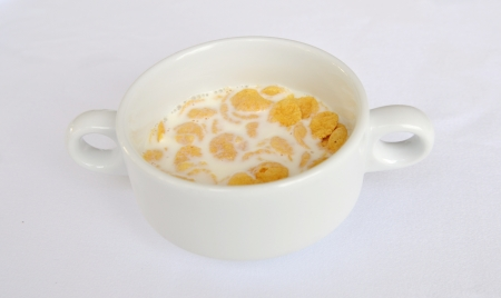 Breakfast with milk and cornflakes photo
