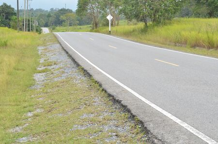 Section of asphalt road in a rural area photo