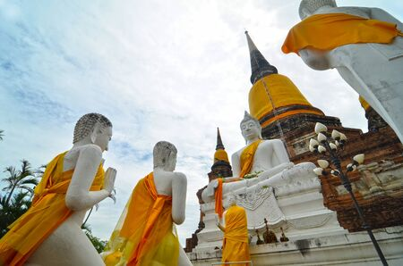 Buddhas and Pagoda in Wat Yai Chai Mongkol at Ayutthaya, Thailand photo