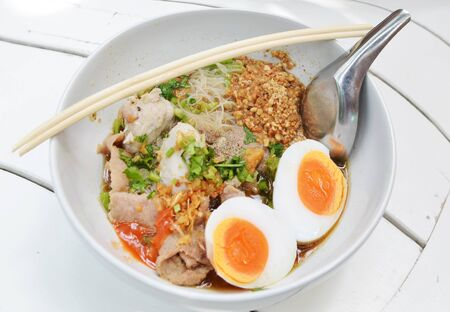 closeup Thai pork Noodles with Boiled egg photo