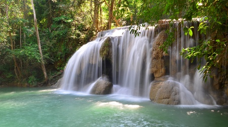 Waterfall into a lagoon at Erawan National Park Thailand photo