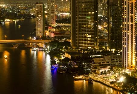 Modern city at night, Thailand photo