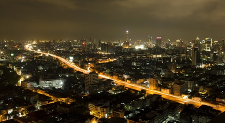 bustling: Modern urban landscape and the bustling streets in the evening Stock Photo