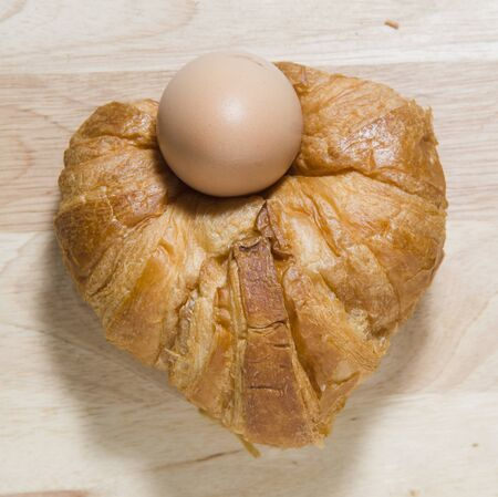 Fresh and tasty croissant and eggs photo