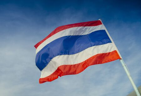 thailand flag with nice sky on flagstaff photo