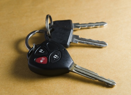 remote car key on brown background photo