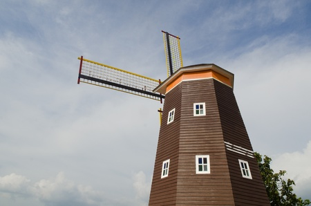 Traditional Dutch windmills with blue sky photo