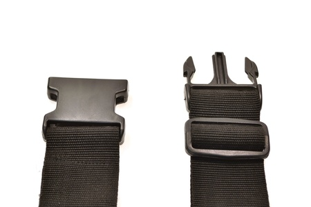 black plastic buckle on strap isolated on white Stock Photo - 17418378