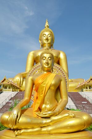 Golden Buddha statue at Wat Muang in Angthong, Thailand photo