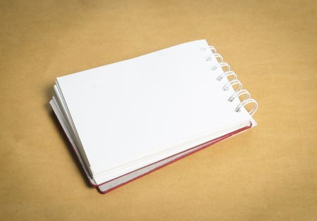 book or notebook on brown vintage background Stock Photo - 17813484