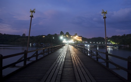 old an long wooden bridge at Sangklaburi,Kanchan aburi province, Thailand photo