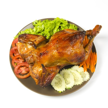 whole grilled chicken served with vegetable photo