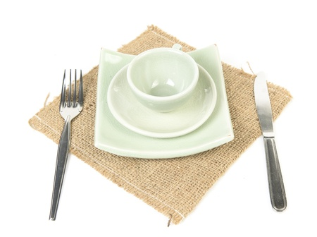 Dinner place setting, isolated on white background. photo
