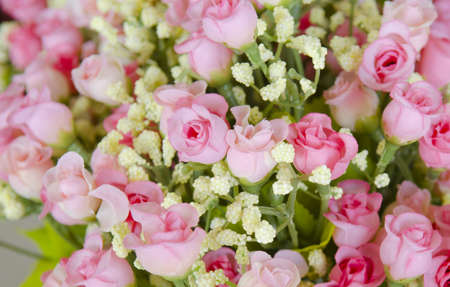 wedding bouquet with rose bush, Ranunculus asiaticus as a background photo