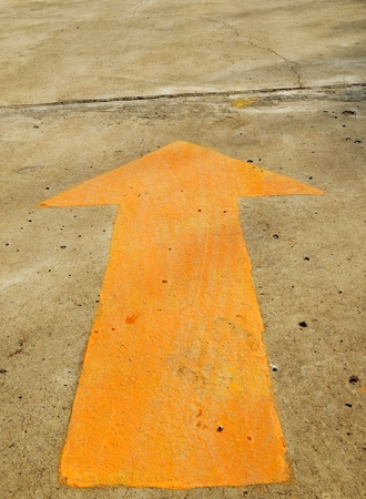 A forwarded yellow arrow on the road photo