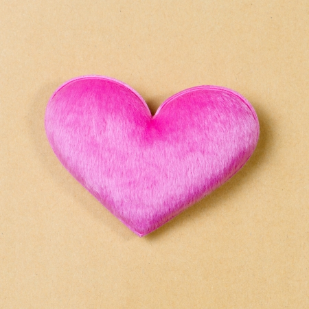 Pink hearts on recycle paper background photo