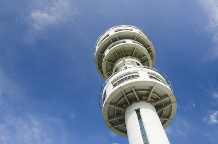 Air traffic control tower with blue sky