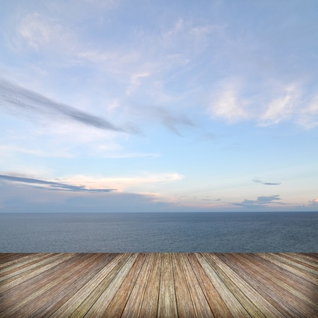 Beautiful sky and ocean with wooden berth photo