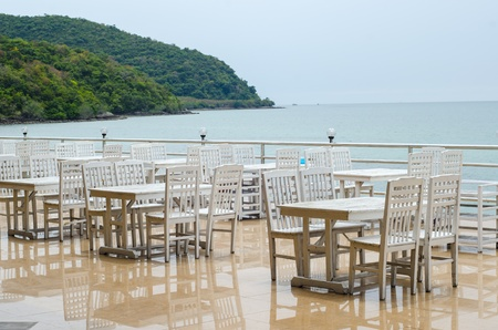 Table in a restaurant by the sea Banco de Imagens