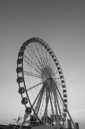 Beautiful large Ferris wheel in black and white photo